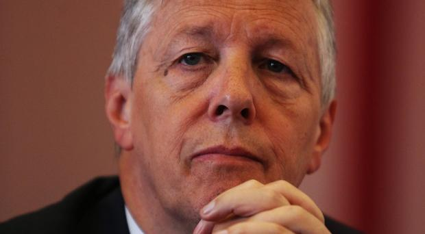 First Minister Peter Robinson blamed political rivals in Stormont for the delay in corporation tax being devolved from Westminster