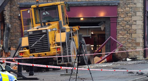 The scene at the supermarket in Moore Street, Aughnacloy, where thieves rammed a digger in to the ATM machine