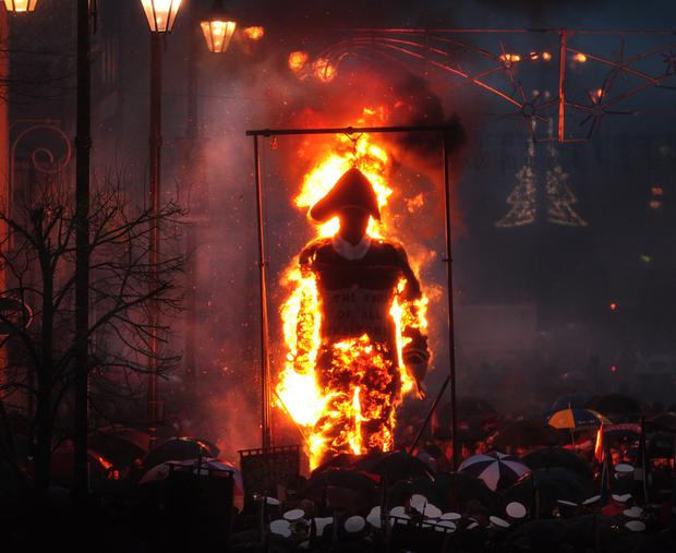 The Apprentice Boys of Derry burn an effigy of Robert Lundy during their parade on Saturday