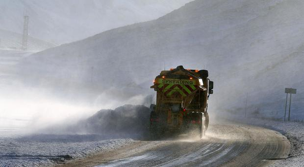 A gritter makes its way along the A93 after snowfall near Glenshee ski centre