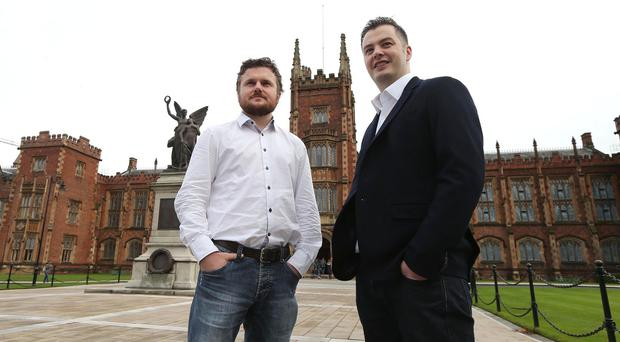 Adoreboard chief technology officer Dr Fergal Monaghan and chief executive Chris Johnston at Queen's University, Belfast (Press Eye/PA)