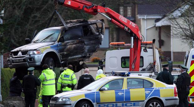 The PSNI vehicle is removed from the scene of the fatal crash on the road between Warrenpoint and Rostrevor in 2008