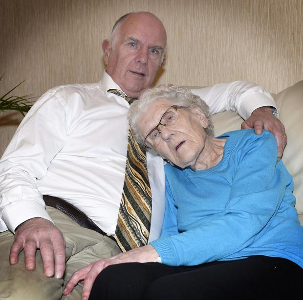 Burglary victim Lilly O'Hara is comforted by her son John at home
