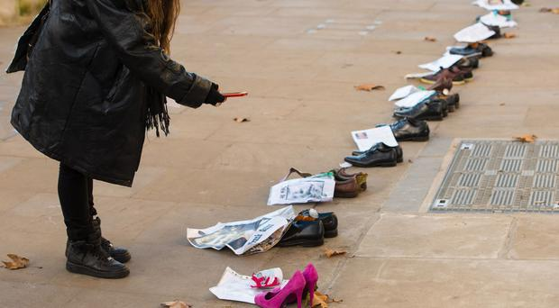 Shoes belonging to victims of the Troubles are lined up along Whitehall in London as part of the In their footsteps campaign to tell the stories of those killed or seriously injured