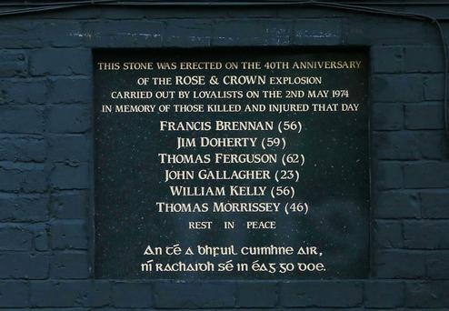The plaque unveiled at the scene where a bomb killed six people in 1974