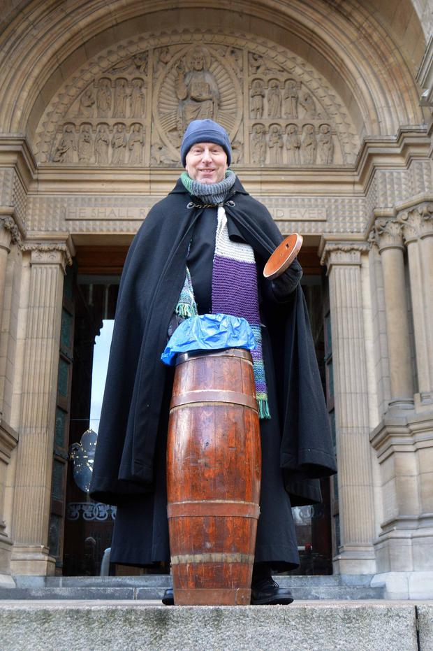 An early donation for Black Santa as he starts his annual sit-out at St Anne's Cathedral in Belfast yesterday