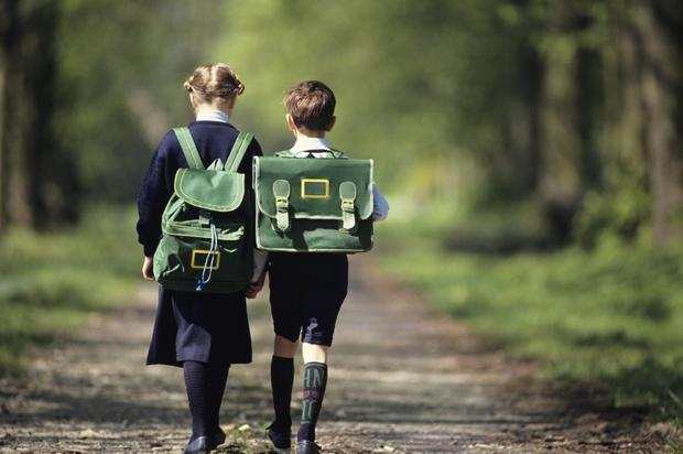 More than 300,000 pupils qualify for free school transport - at an average cost of £800 per pupil. Picture posed