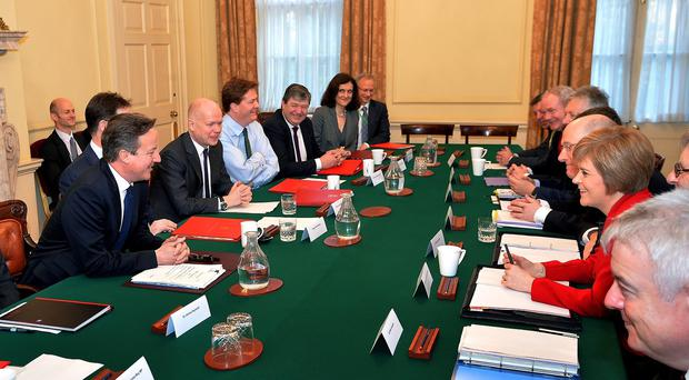 Prime Minister David Cameron sits opposite Scotland's First Minister Nicola Sturgeon before the start of a Joint Ministerial Committee meeting at 10 Downing Street, London