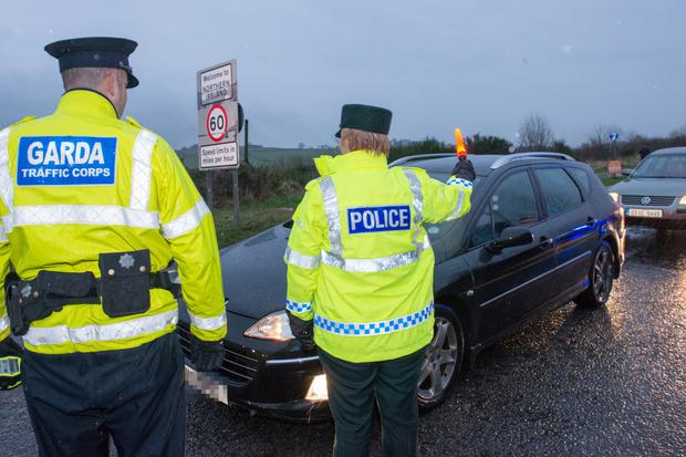 PSNI and Garda officers on duty at the border yesterday during an exercise as part of a joint anti-drink and drive campaign