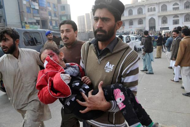 A girl is rushed to a hospital after her school is attacked by Taliban