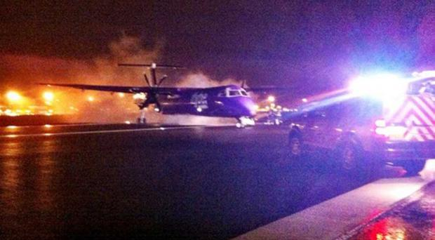 The plane moments after it landed at Belfast International Airport last night