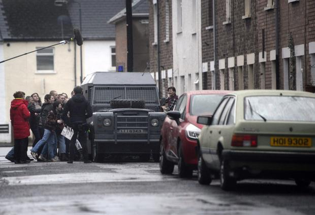 Filming takes place in Olympia Drive in Village area of south Belfast yesterday for U2 video