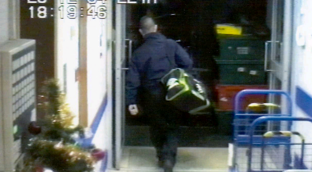 CCTV footage of an employee leaving the bank with a bag containing £1m in cash as part of the £26.5m raid on the Northern Bank headquarters