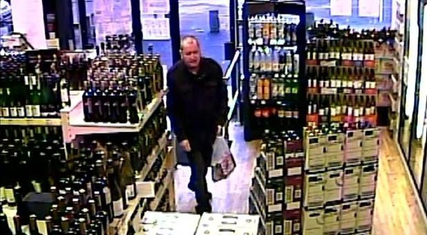 A CCTV image of Basil McAfee in an off-licence - the last sighting of him alive