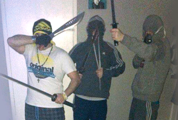 Social media photos of the thugs posing with weapons