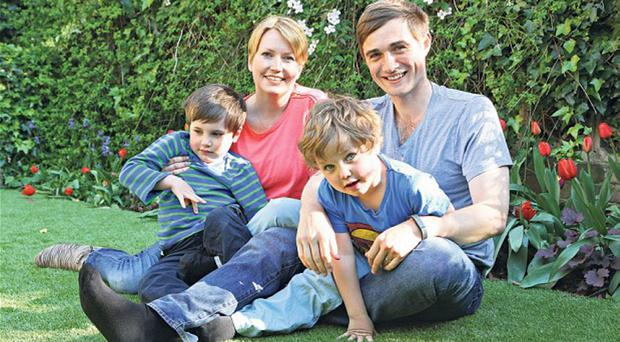 Kate at home with husband Billy and sons Oscar (left) and Isaac