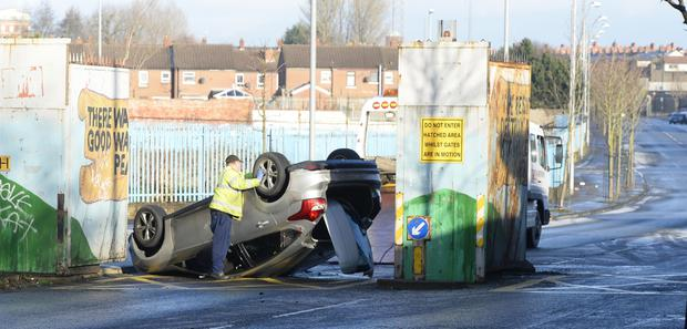 A family avoided injury in west Belfast yesterday after their car overturned on the ice at Lanark Way