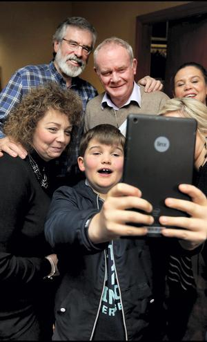 Sinn Fein president Gerry Adams poses with (from left) Culture, Arts and Leisure Minister Carál Ní Chuilín, Deputy First Minister Martin McGuinness and party vice president Mary Lou McDonald for a selfie taken by Mary Lou's son Gearoid (8) at the party's ard chomhairle