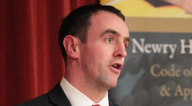 Environment minister Mark H Durkan's decision to grant planning permission to the multi-million pound Carnbane Way scheme is being opposed by traders