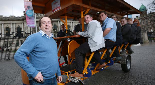 Ron Kenna, owner of Wee Toast Tours, with some participants who took the opportunity to try out his pedal-powered bar stool