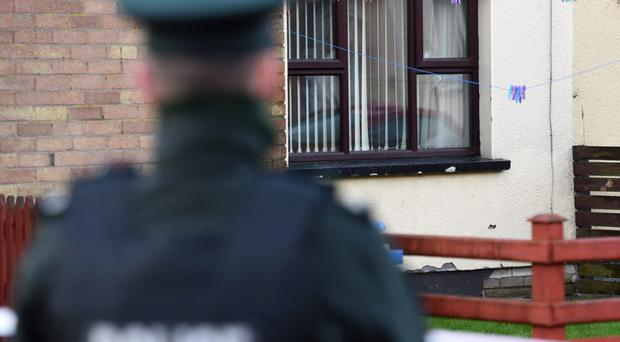 Police at the scene of the shooting in Omagh at McClay Park