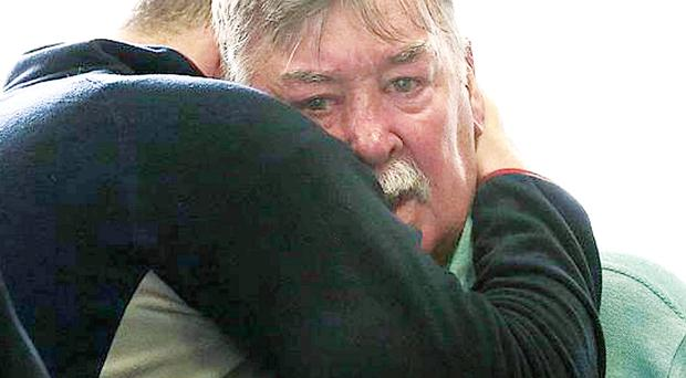 Barry Lyttle (left) embraces his father Oliver outside Sydney's Central Local Court yesterday