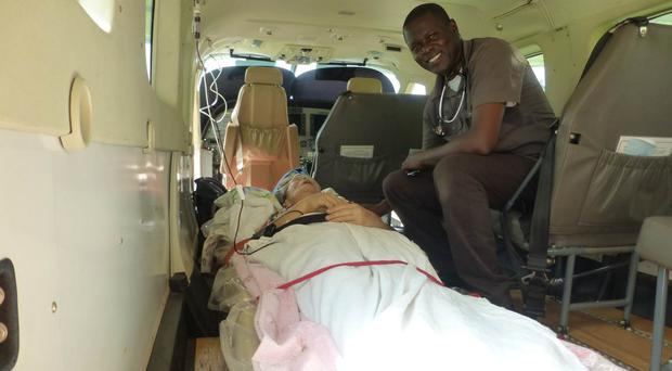 Missionary Maud Kells being evacuated to hospital by plane after being shot by bandits in Mulita