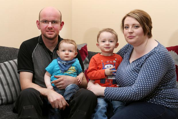 Elisha McGill and her husband Dermot with Bobby (nine months) and 22-month-old Ollie in their Aghadowey home yesterday