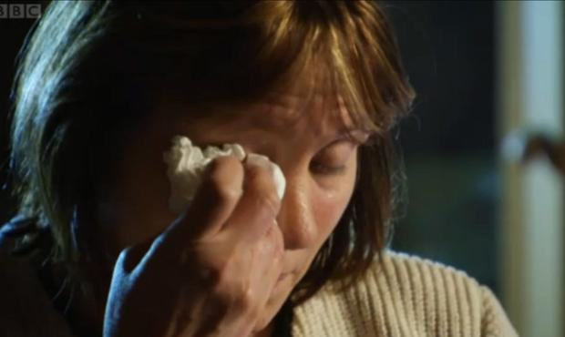 Jenny Palmer wipes away a tear during an interview on BBC's Spotlight programme
