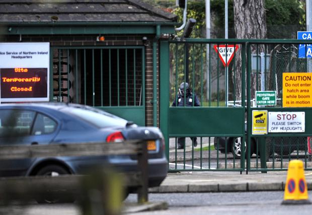 An Army bomb disposal expert moves in to examine the suspect package behind the closed gates of PSNI headquarters in east Belfast