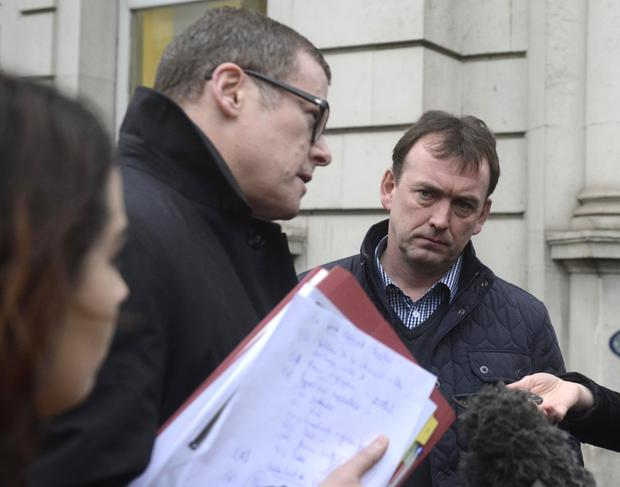 Damian Brown (right), son of Sean Brown, with solicitor Kevin Winters outside inquest yesterday