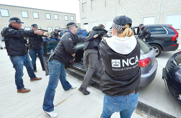 Officers of the National Crime Agency during a training exercise in England