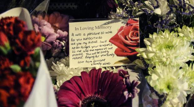 Floral tributes left outside the Double Value takeaway owned by Nelson Cheung