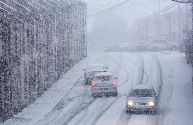 Snow brought traffic chaos to the north west yesterday