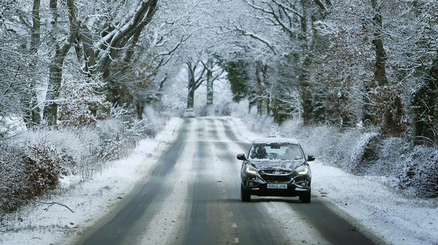 A car negotiates the A93 near Guildtown as snow brings fresh disruption to parts of the UK