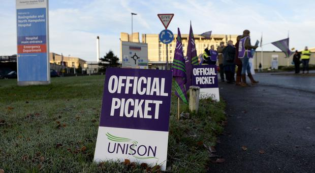 Pickets in a pay protest outside the Basingstoke and North Hampshire Hospital
