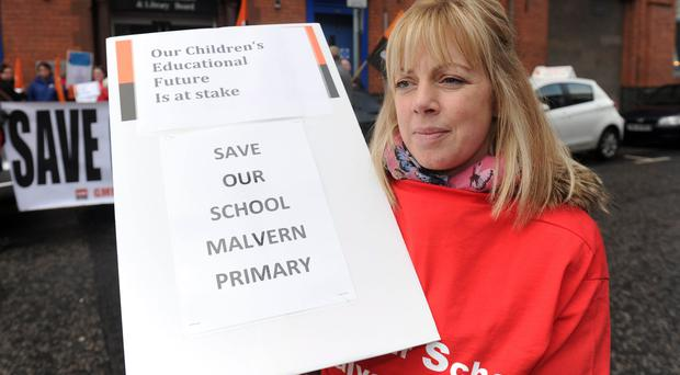 A group of protesters gathered outside the BELB headquarters on Academy Street in Belfast yesterday to protest at the potential closure of Malvern Primary School