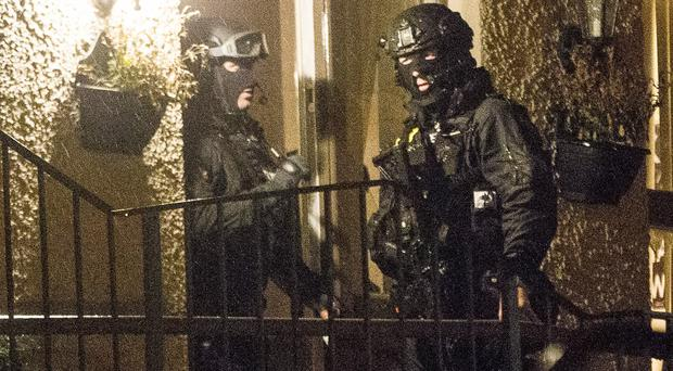 Armed and masked police raid an address in Newry leading to the arrest of suspected dissident republican terrorists