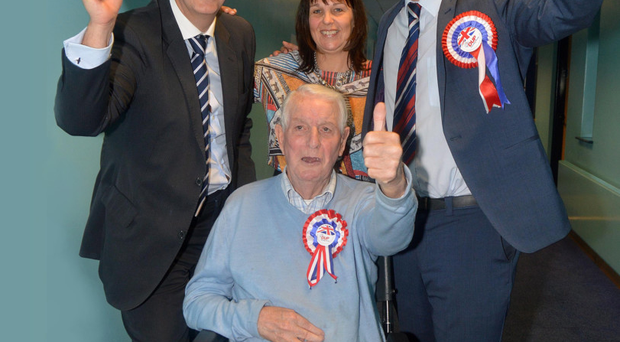 Luke Poots, son of Edwin Poots (left), celebrates his election to the new Lisburn-Castlereagh Council for the DUP with his grandfather Charles Boucher and his mother Glynis