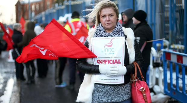 Medical secretary Claire McDonnell takes part in a 12-hour strike against pay constraints outside the Royal Victoria Hospital in Belfast