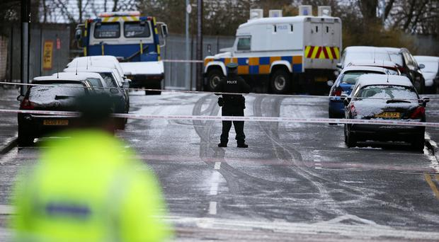Police on Botanic Avenue, Belfast, after a man was found stabbed to death