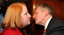DUP leader Peter Robinson congratulates Alliance's Naomi Long after her victory in 2010