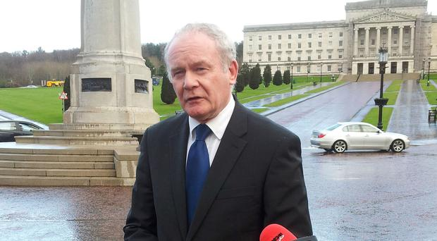 Sinn Fein's Martin McGuinness speaks to the media outside Stormont House following talks on the latest political deal in Northern Ireland