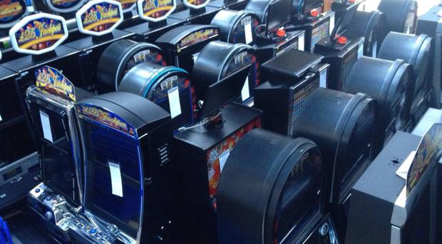 Police have confiscated a huge haul of gambling equipment from premises in Belfast and Lisburn