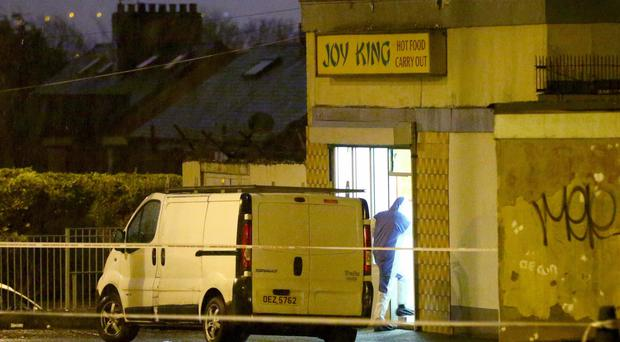 Police officers at the scene where Harry McMahon was shot on the Oldpark Road in north Belfast. Picture: Kevin Scott / Belfast Telegraph