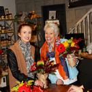 Caroline Henderson helps Pamela Ballantine with her bouquet