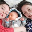 Trio: Caleb Munster with his big sisters Zoe and Naoise