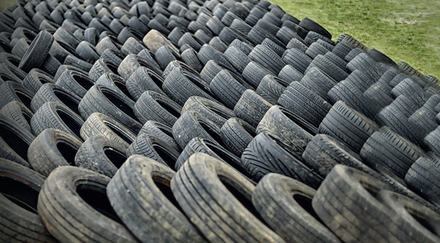 A line of hundreds of tyres gathered for the Eleventh Night bonfire in the New Mossley estate