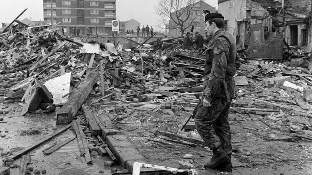 A soldier stands guard over the shattered remains of McGurk's bar in Belfast, where 15 people died in the 1971 bomb blast