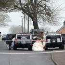 Members of the wedding party leave the church after the shooting